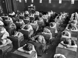 alfred-eisenstaedt-elementary-school-children-with-heads-down-on-desk-during-rest-period-in-classroom
